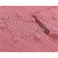 Knitted pink dress with a pompom